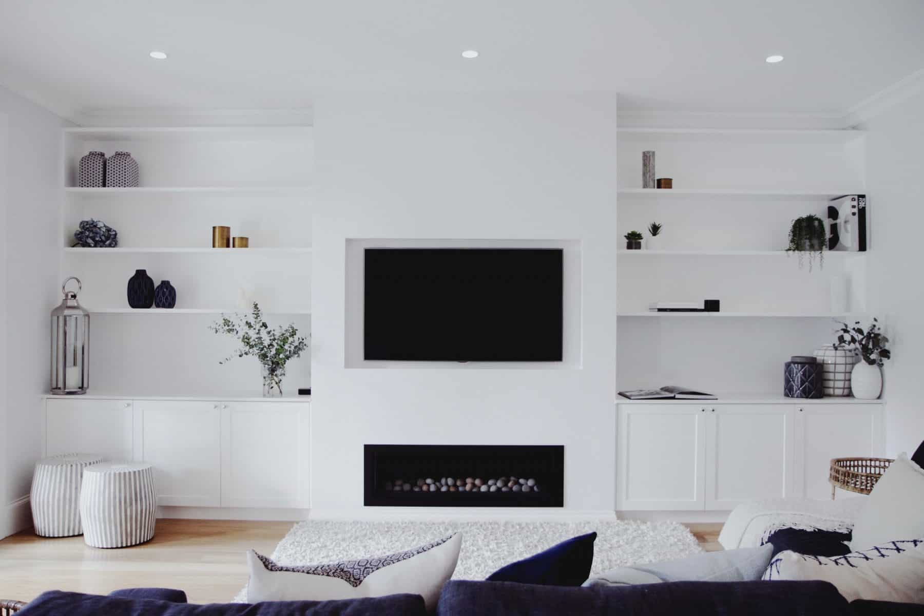 Integrated TV Unit with fireplace, bookshelves and custom joinery.