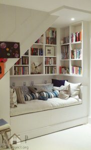 Under stairs Seating design reading nook bookcase hamptons